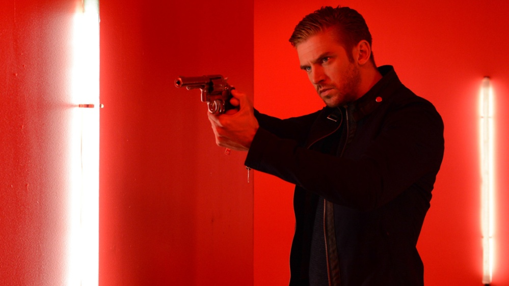 Even in this most red of shots, Dan Stevens still has eyes of coolest blue